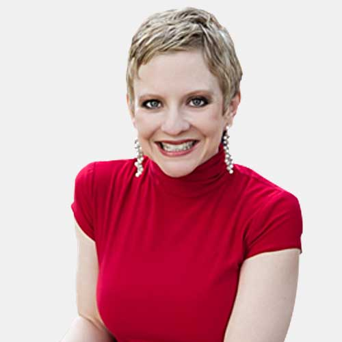 smiling woman with blonde hair wearing red shirt and earrings