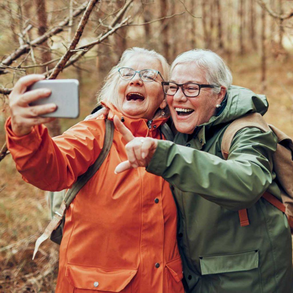 two older women outside taking selfie