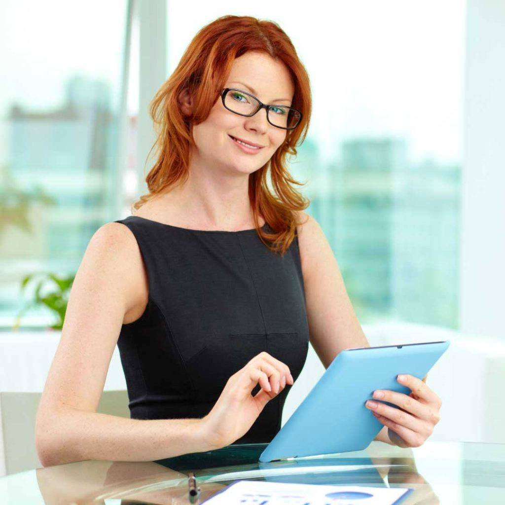 woman wearing  glasses holding a tablet